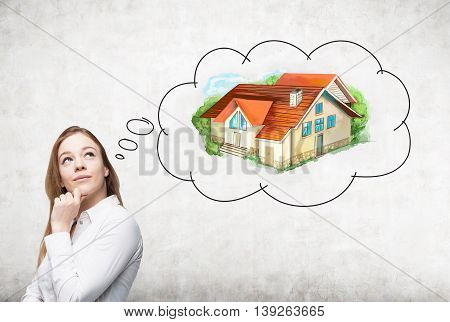 Thoughtful european businesswoman thinking about real estate on concrete background. Mortgage concept