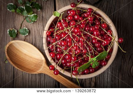 Redcurrant In Wooden Bowl.