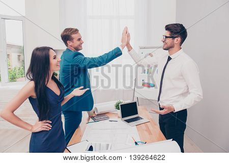 Young Smiling Men In Formalwear Handshake In Office