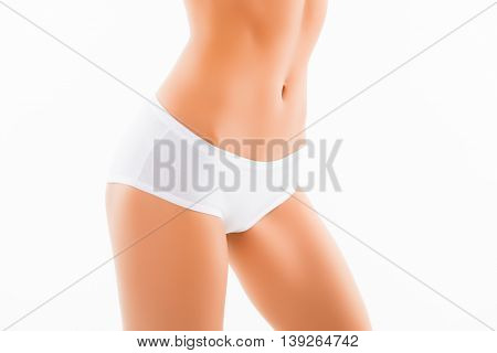 Close Up Photo Of White Women's Drawers And Slim Belly