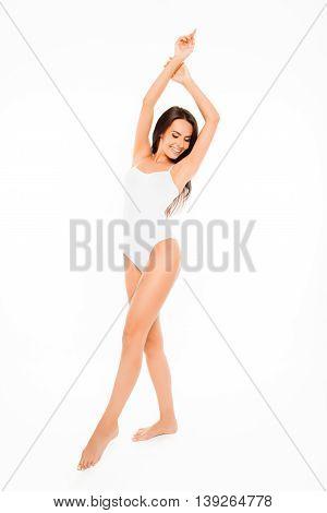 Full Length Portrait Of Slim Happy Woman In White Swimsuit