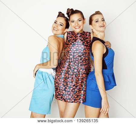 group of stylish ladies in bright dresses isolated on white smiling having fun, watching selfie, posing cheerful, lifestyle concept