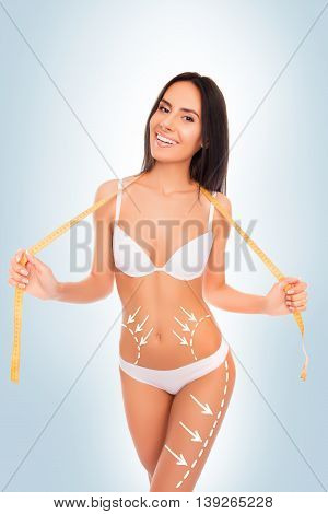 Cheerful Happy  Slim Brunette With Perfect Figure  Posing With Measuring Tape