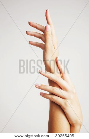 beauty delicate hands with french manicure close up isolated on white, real elegant woman