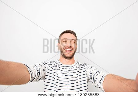 Handsome Smiling Happy Man Making Selfie On White Background
