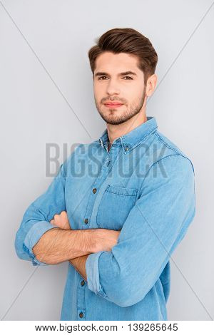 Portrait Of Calm Handsome Young Brunet With Crossed Hands