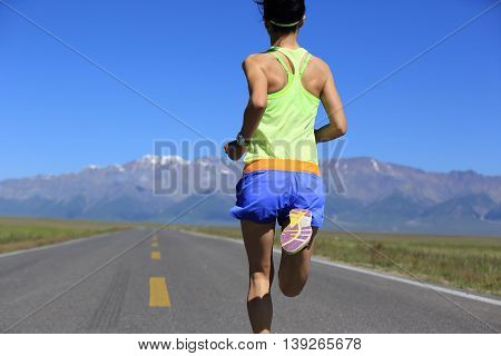 healthy lifestyle young woman runner running on trail