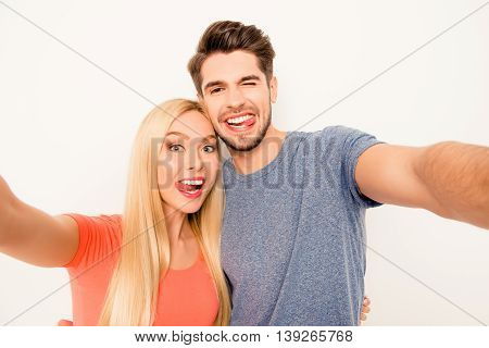 Comic Selfie Of Man And Woman In Love Showing Tongues