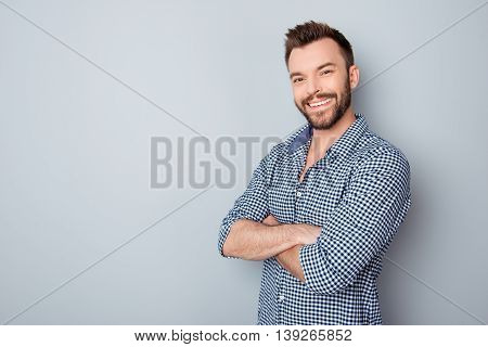Portrait Of Toothy Handsome Bearded Man With Crossed Hands