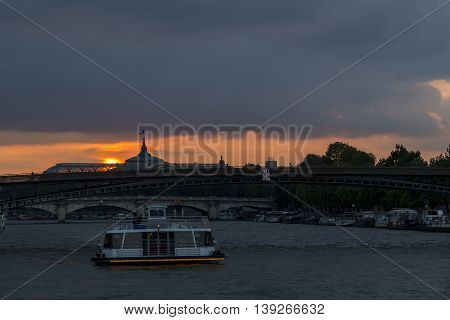 PARIS, FRANCE - MAY 15, 2015: This is view of the sunset during a river walk along the Seine River.
