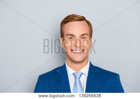 Portrait Of Happy Successful Cheerful Businessman With Beaming Smile