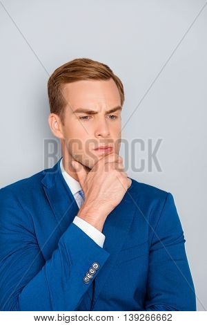Portrait Of Young Ponder Businessman Touching His Chin