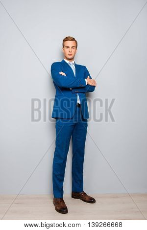 Full Length Portrait Of Handsome Man In Suit With Crossed Hands
