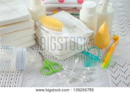 Baby accessories for hygiene on tablecloth