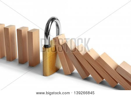 Wooden blocks and yellow lock isolated on white