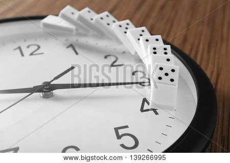 Dominoes on clock, closeup