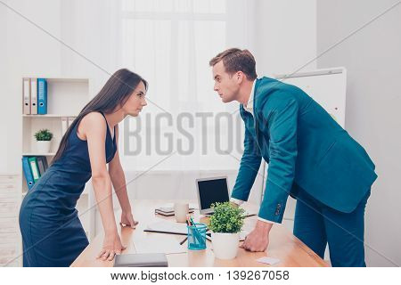 Business competition. Two colleagues having disagreement and conflict