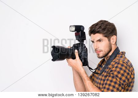 Portrait Of Young Handsome Professional Photographer Taking Photo