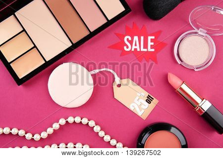 Make up product on pink background. Sale concept