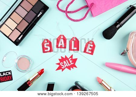 Make up product on blue background. Sale concept