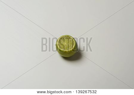 Fresh juicy tasty green lime on white background.