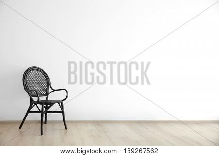 Cozy chair on wall background
