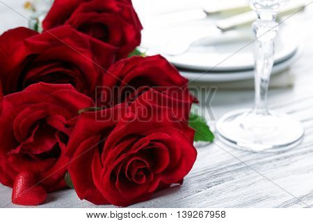 Red roses on holiday served table