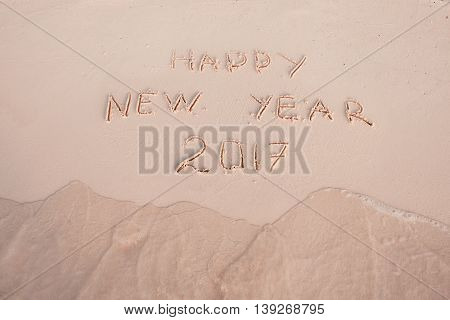New Year 2017 is coming concept. Inscription Happy New Year 2017 replace 2016 concept on the sea beach