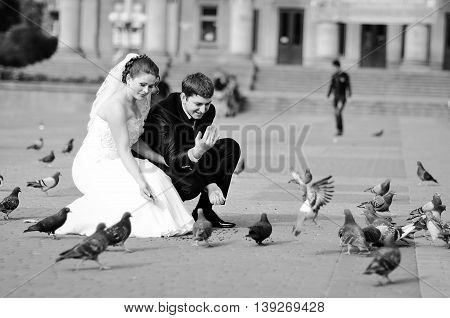 Newlyweds At Theater Square With Many Pigeons