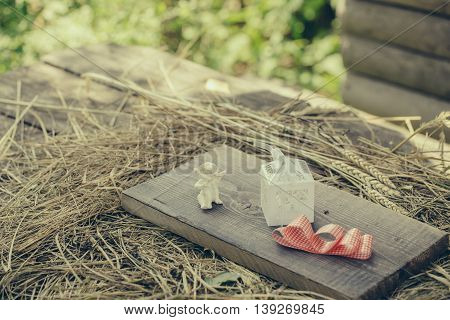 Angel Box And Ribbon On Wooden Board