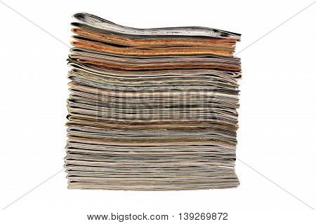 Stack of sewing magazines isolated on white background with clipping path