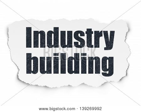 Manufacuring concept: Painted black text Industry Building on Torn Paper background with  Tag Cloud