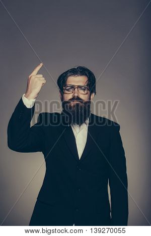 Handsome Man Points Forefinger Upwards