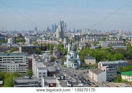 Temple of St. Sergius of Radonezh, Stalin skyscraper and office skyscrapers at sunny day in Moscow