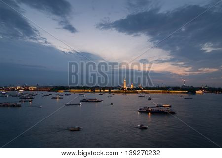 Neva river, ships, Peter and Paul fortress in Saint Petersburg, Russia in evening