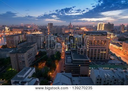 Smolenskaya Square and stalin skyscraper on horizon at evening in Moscow, Russia