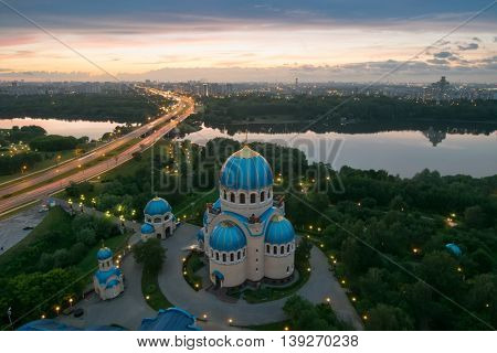 Temple of Holy Trinity, highway, river, sunset and panorama of Moscow, Russia