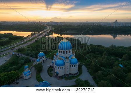 Temple of Holy Trinity, highway, sunset and panorama of Moscow, Russia