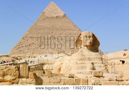 Great Sphinx of Giza. Giza, Egypt - February 1, 2009: Tourist visiting the most famous Egyptian Sphynx in Giza, Egypt. It is a limestone statue of a reclining sphinx that stands on the Giza Plateau.