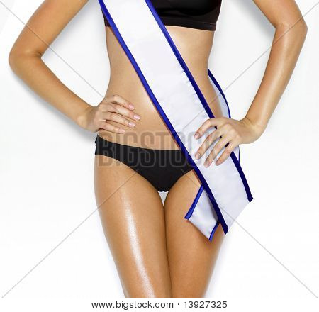 part of woman shape of beautiful thigh in bikini with white tape of beauty contest