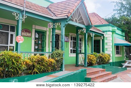BRIDGETOWN, BARBADOS - NOV 2015 : Shopping district at Pelican Craft Centre, Bridgetown, Barbados. Opened in 1999, this marketplace offers restaurants, crafting demos, jewelry making sessions and local artisan shops for browsing.
