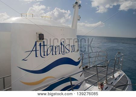 BRIDGETOWN, BARBADOS - NOVEMBER 2015:  Atlantis Submarine near Bridgetown, Barbados. Atlantis is a popular tourist attraction  and cruise excursion vehicle.