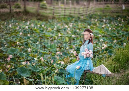 Asian Office Woman, Ao Dai Is Famous Traditional Costume For Woman In Vietnam