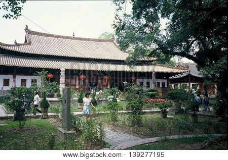 GUANGZHOU / CHINA - CIRCA 1987: Buddhists worship at the Guangxiao Buddhist Temple, also known as the Bright Filial Piety Temple.