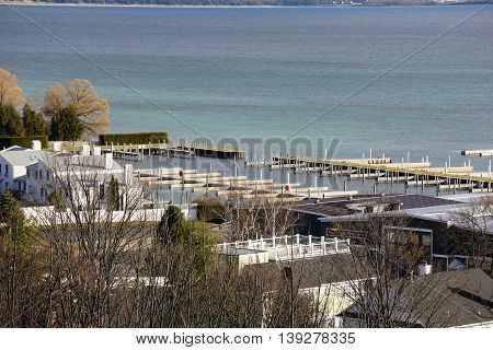 A view of the boat docks in front of the Marina Village Condominiums, as seen from the bluff above downtown Harbor Springs, Michigan, on Christmas Day, 2015.