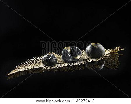 Dim sum on pine leaf in black background