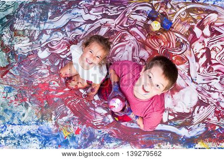 Happy Girl And Boy Painting With Their Hands