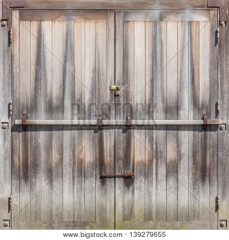 Retro entrance door with rustic locked bolt in Farmland.
