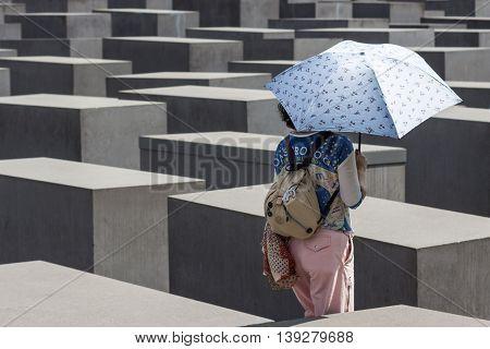 Tourist At Holocaust Memorial / Jewish Memorial In Berlin