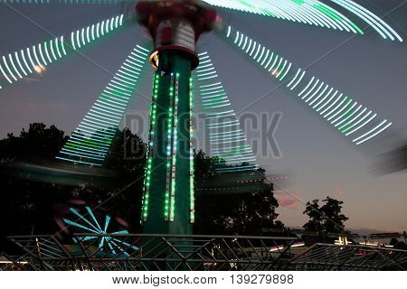 Amusement park ride at a county fair at dusk